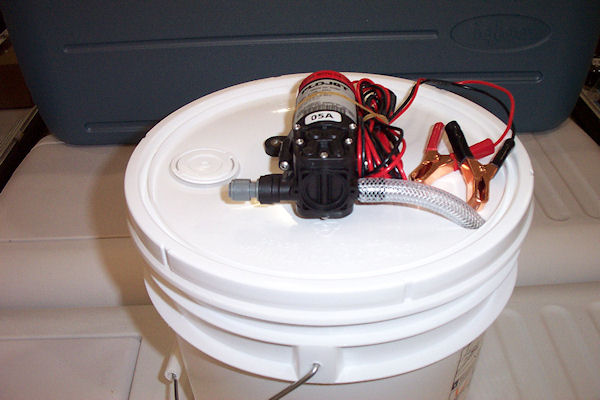 Bucket Mounted Oil Change Pump